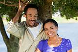 Happy Romantic African American Couple Smiling Under A Tree