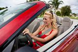 Beautiful Young Woman Driving Convertible Car Wearing Sunglasses