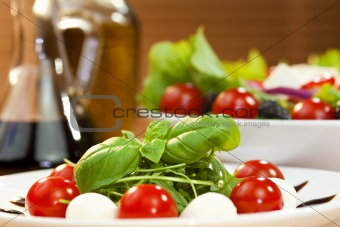 Tomato Mozarella Rocket or Rocquet Salad With Olive Oil and Bals