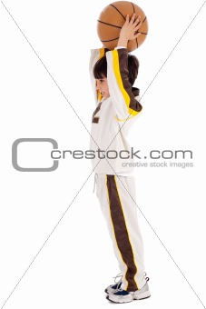 Caucasian boy playing basket ball