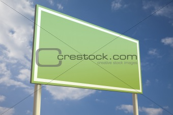Green sign in front of a blue sky