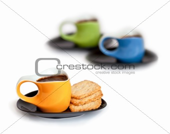 Three coffee cups with cookies