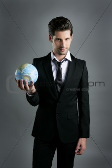 World globe map sphere in businessman hand