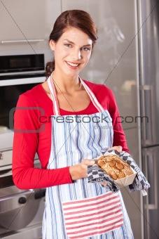 Beautiful woman showing her cake