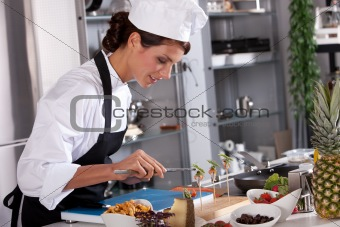 Beautiful chef working on her dishes