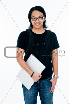Happy young male student holding a laptop