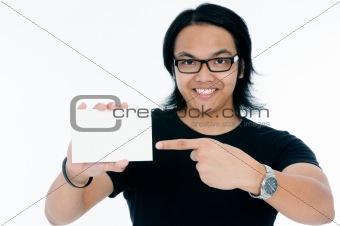 Happy young man showing a blank business card