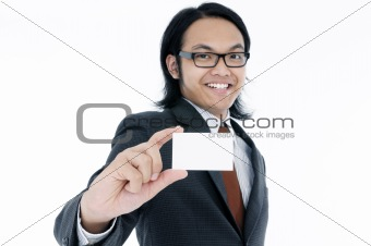 Happy young man holding a blank card