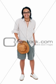 Happy young man standing against white background