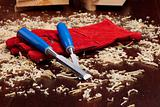 Chisels, red gloves and wood shavings