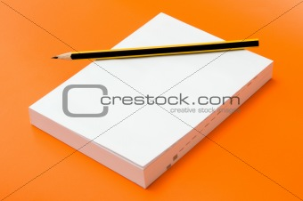 blank book and pencil