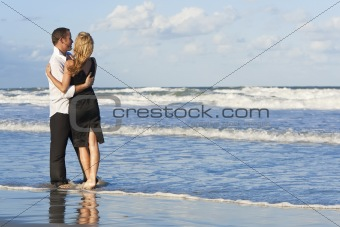 Man and Woman Couple Having Fun Embracing On A Beach