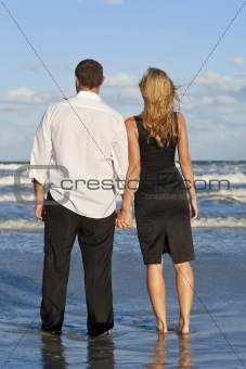 Man and Woman Couple Holding Hands On A Beach