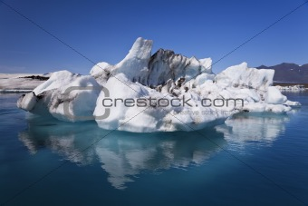 Iceberg and Reflection on the Lagoon, Jokulsarlon, Iceland