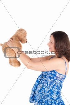 Portrait of pretty pregnant woman with toy