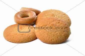 Three yellow cookies and two bread-rings