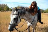 Beautiful girl riding a horse