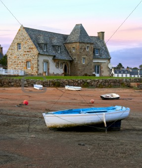Ancient house and boats on a mooring - beautiful scenery at sunset