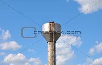 Water tower over blue sky