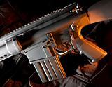 Side lit assault rifle with orange