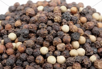 Heap of black and white pepper