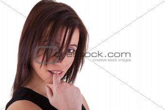Beautiful young woman touching lips