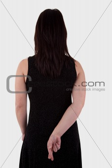 young woman seen from behind, his hands back, her fingers crossed