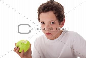 boy eating a green apple