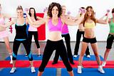 women doing aerobics with dumbbell