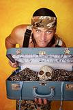 Man with skull in suitcase