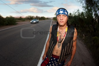 Indigenous man by the side of the road