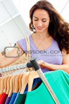 Glowing hispanic woman looking for clothes