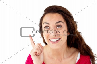 Cheerful hispanic woman pointing upward