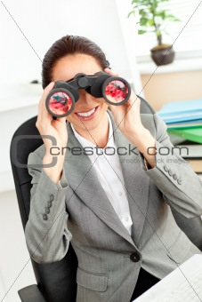 Bright hispanic businesswoman looking through binoculars sitting
