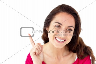 Beautiful hispanic woman pointing upward