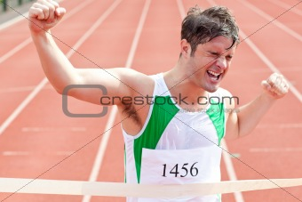 Exulting sprinter showing expression of victory in front of the