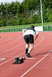Athletic man running in a stadium