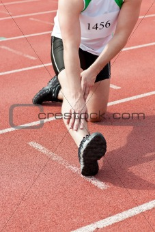 Male sprinter warming up