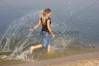 a young girl hurries on water