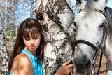 Beautiful girl with a horse