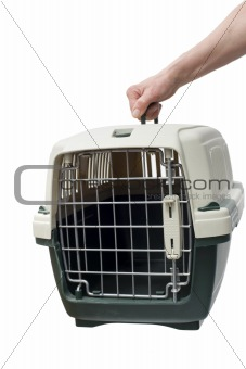 one hand holding a pet carrier