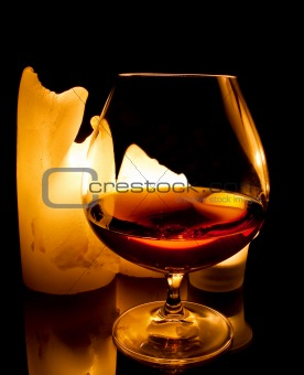 candles and a glass of brandy