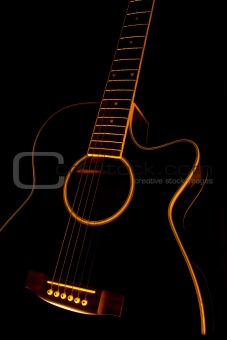 A black guitar in flames