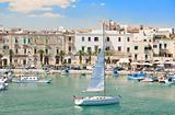 Trani touristic port with sailing boat. Apulia.