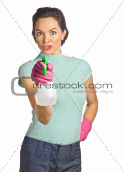 Portrait of beautiful young housewife with spray bottle