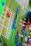 Green circuit board without components.