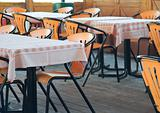 Table and chairs in empty restaurant.