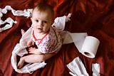 Baby tearing up paper