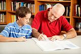 Dad Helps Son with Homework