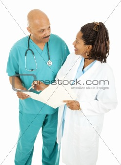 Doctors Going Over Medical Chart
